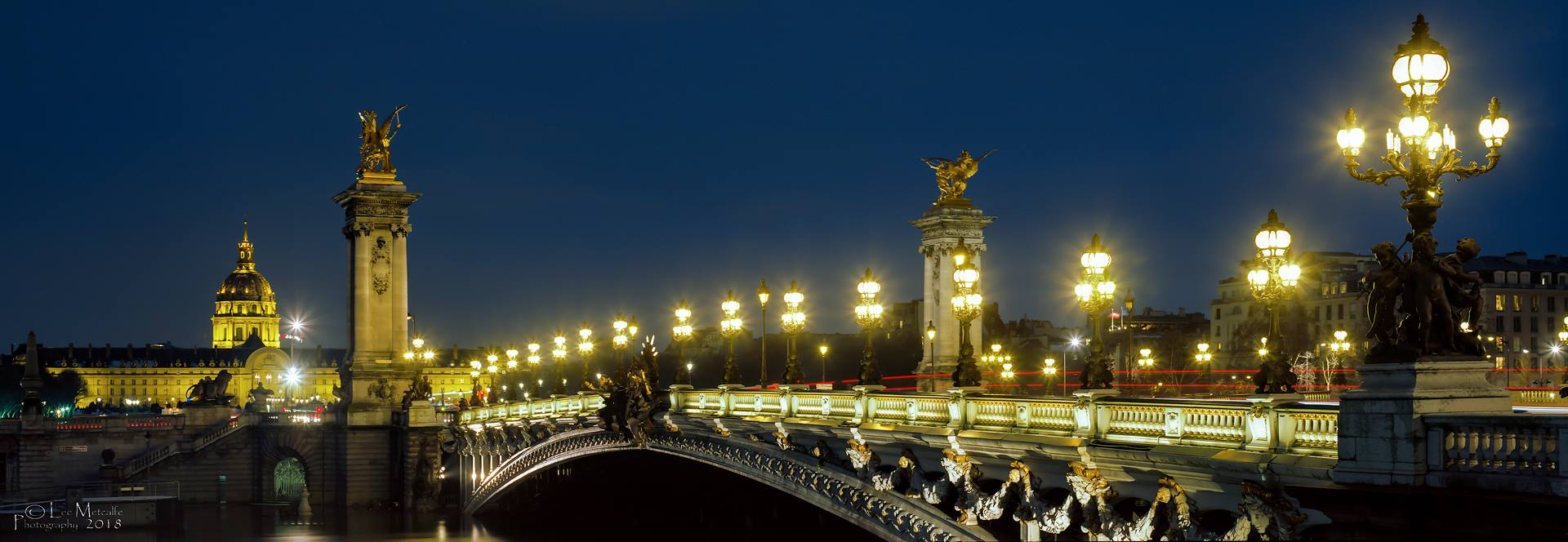 Pont Alexandre III, Hotel des Invalides and the River Seine at night, Paris, France